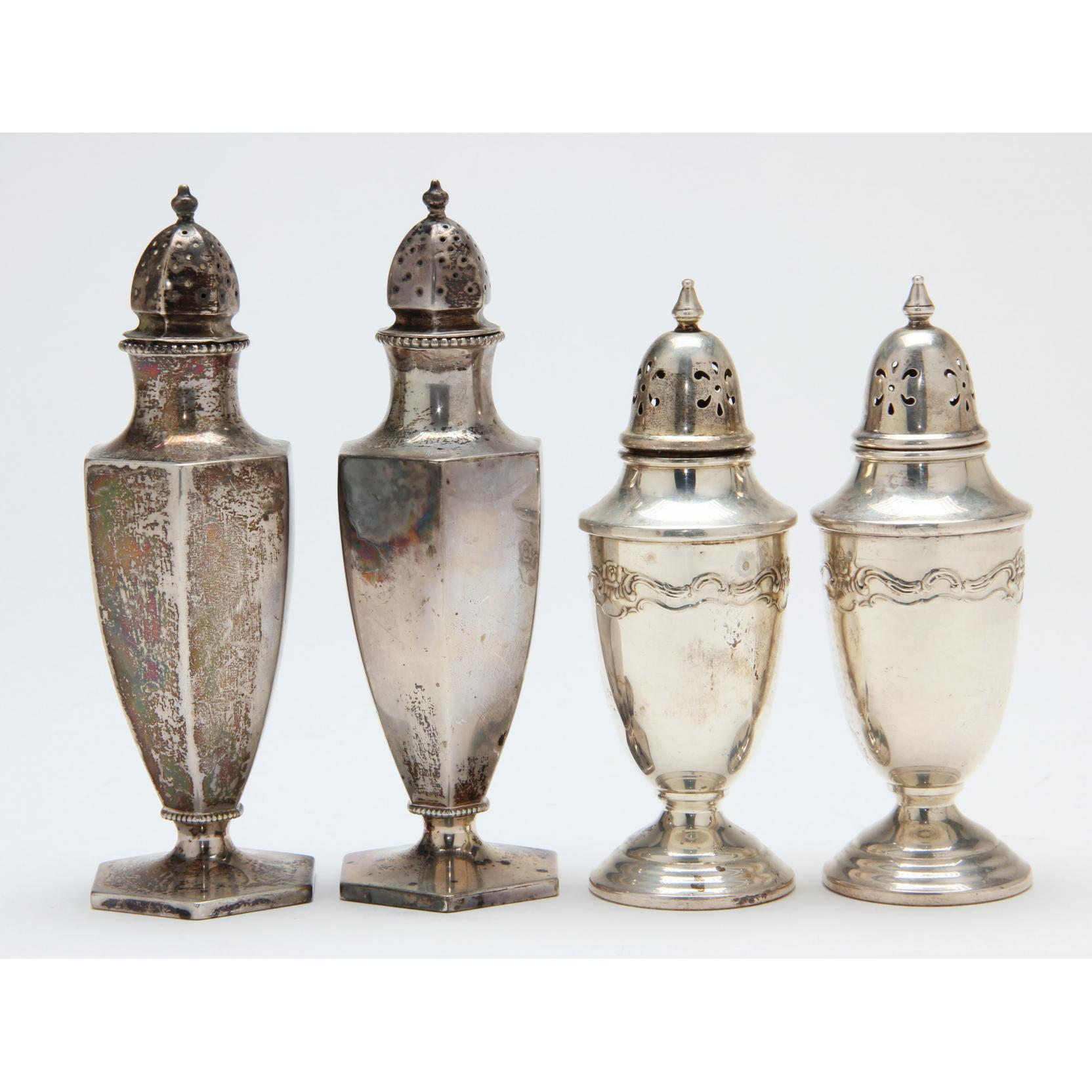 two-pairs-of-sterling-silver-salt-pepper-shakers