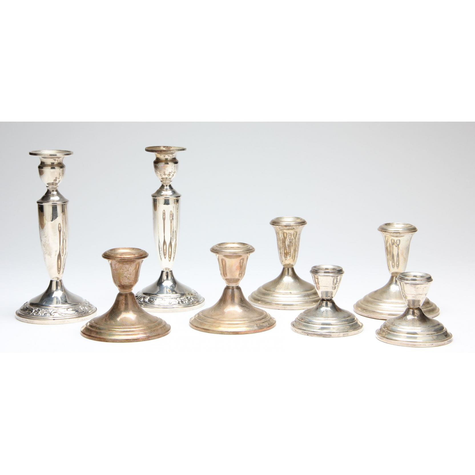four-pairs-of-sterling-silver-candlesticks