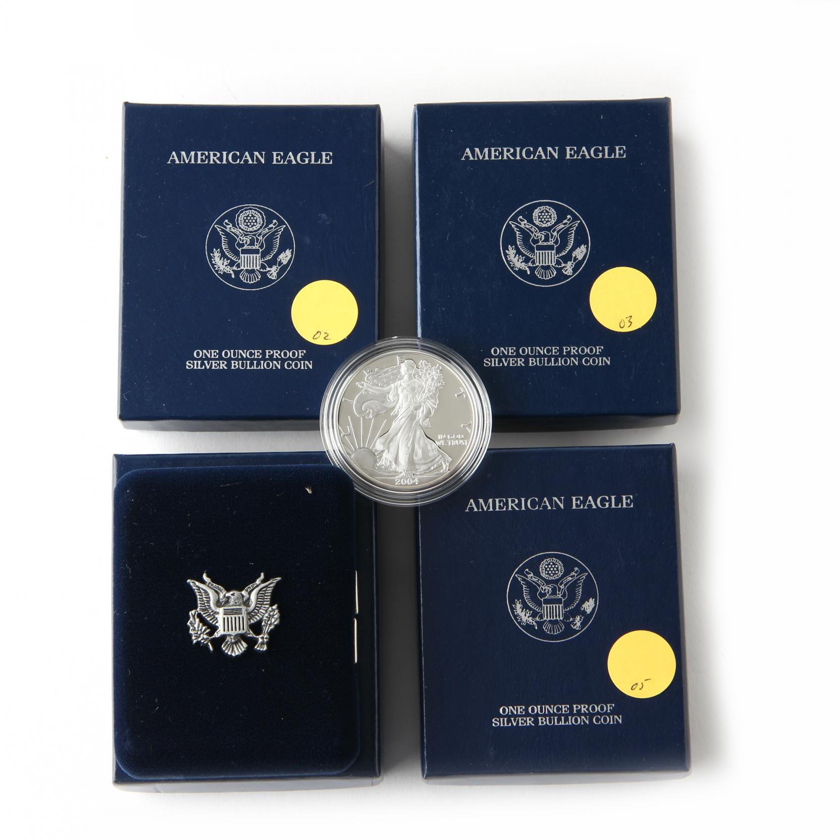 four-different-proof-american-eagle-silver-bullion-coins