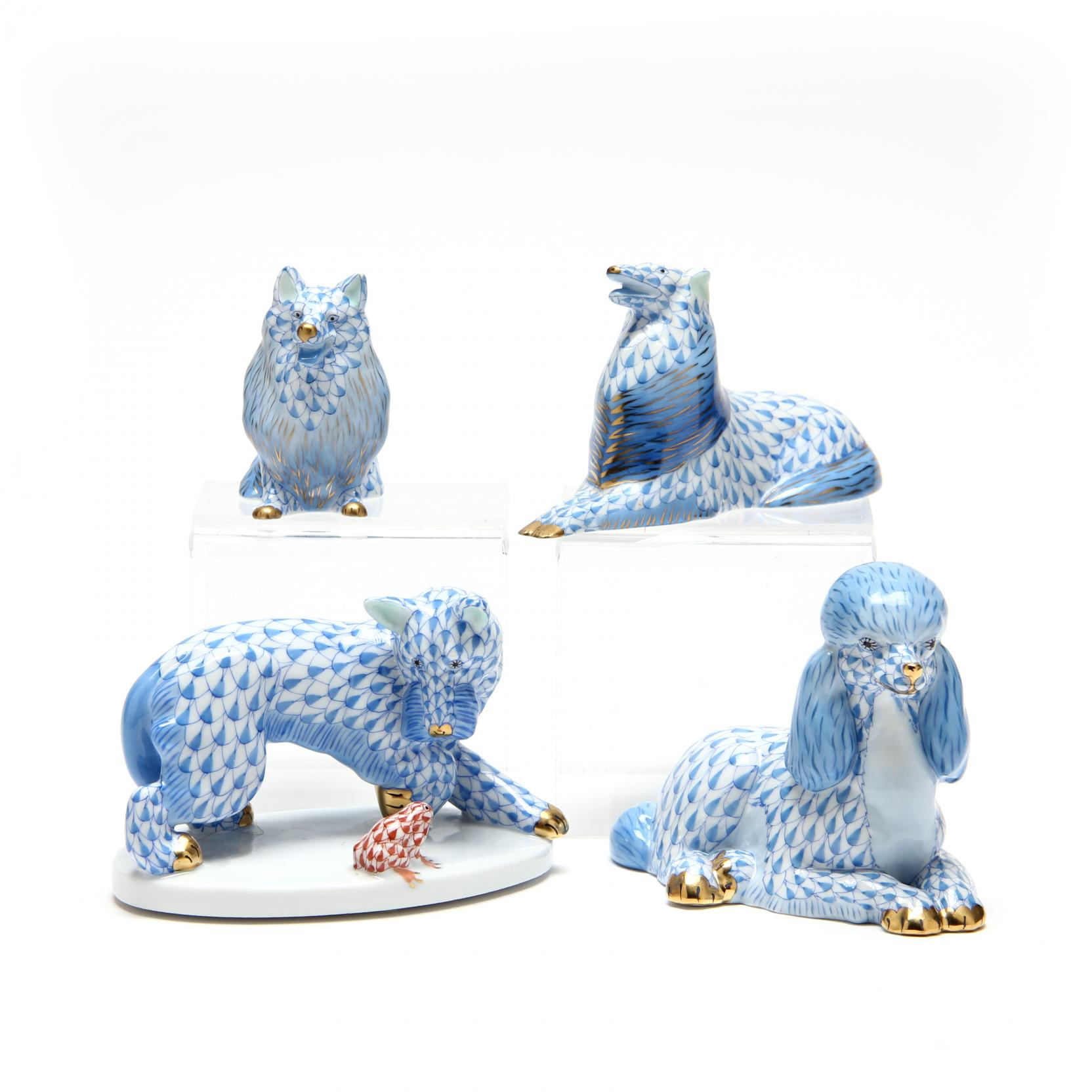 a-group-of-four-herend-dog-figurines