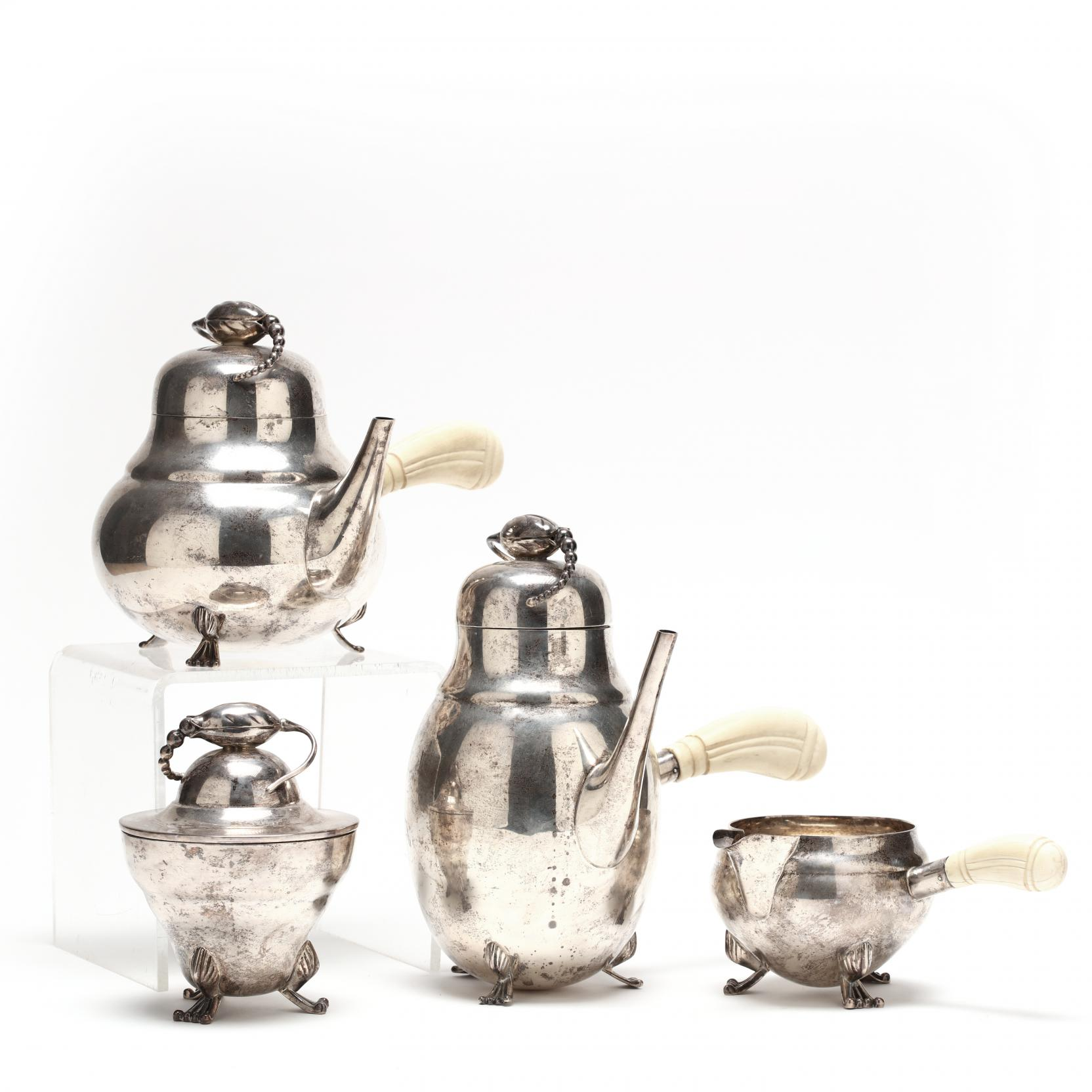 an-american-sterling-silver-tea-coffee-service-in-the-style-of-georg-jensen-blossom