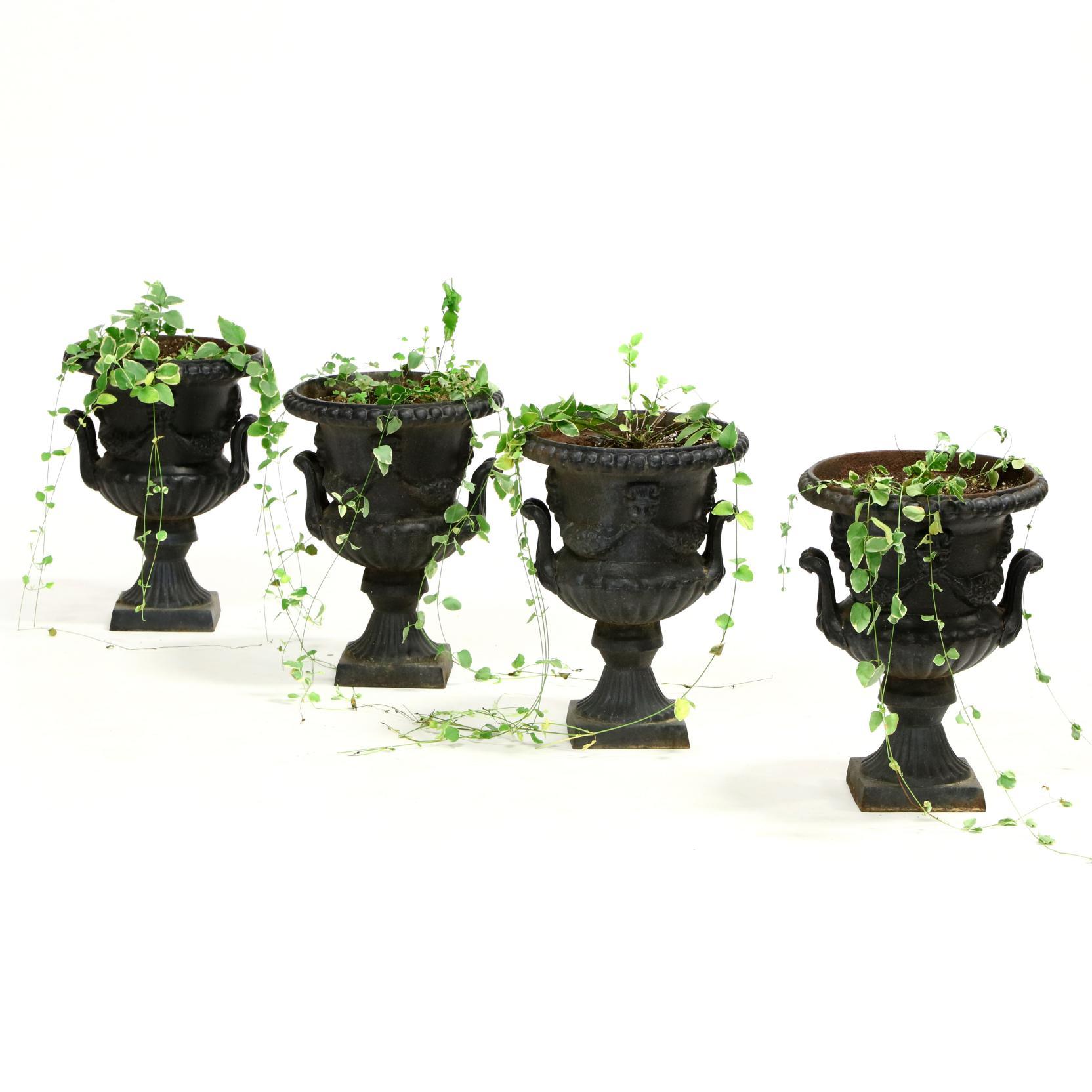four-diminutive-cast-iron-urns