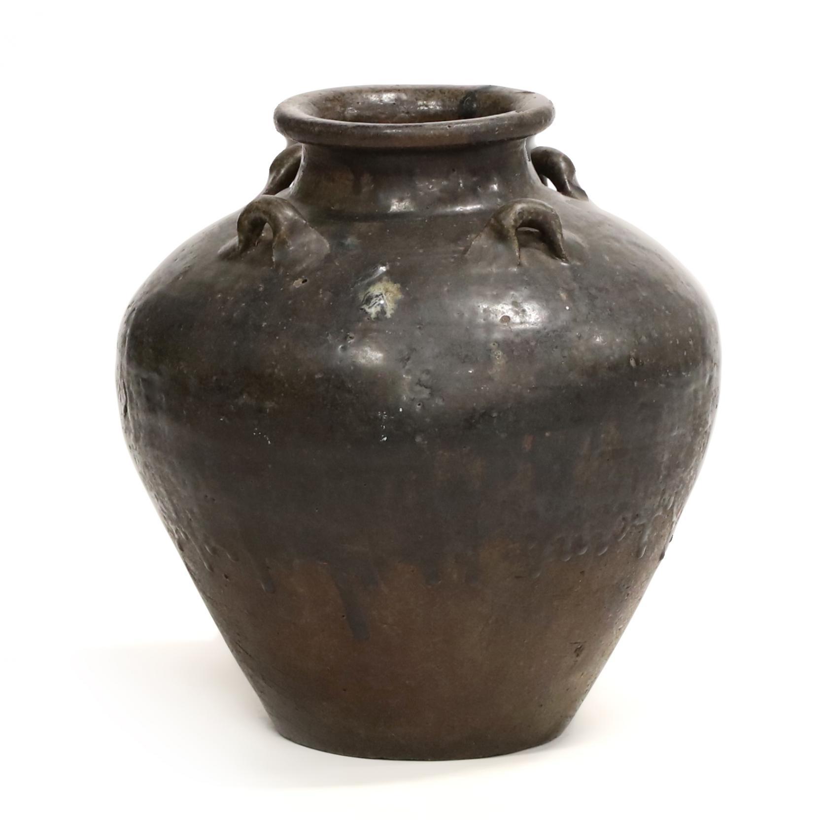 an-asian-large-black-glaze-jar
