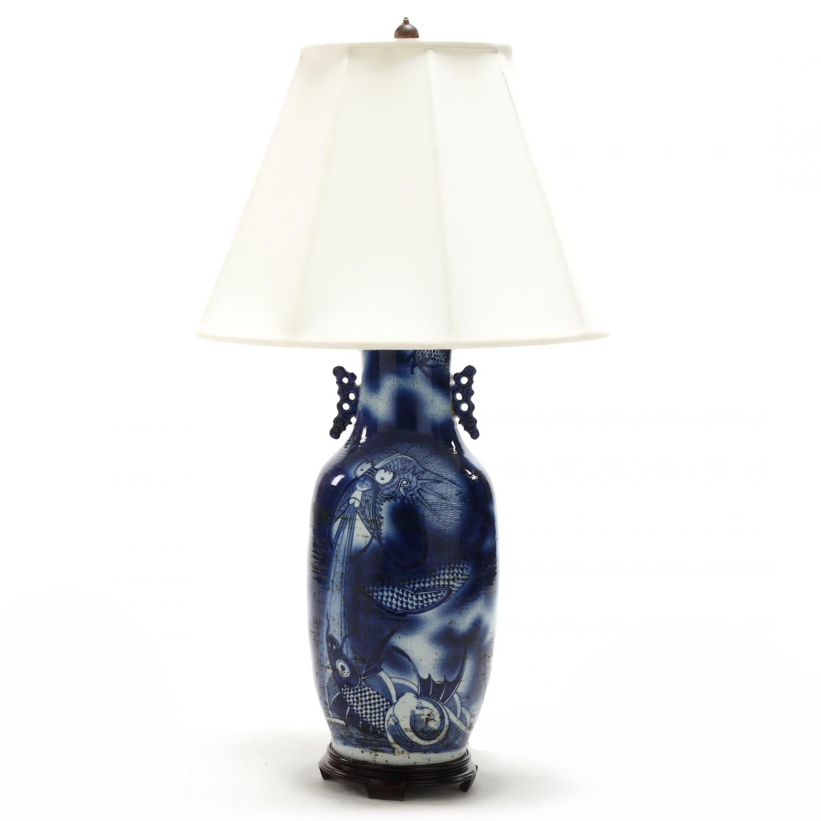a-blue-and-white-vase-with-dragon-and-koi-fitted-as-lamp