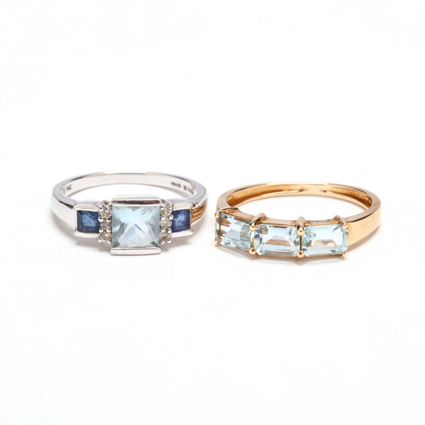 two-gold-and-aquamarine-rings