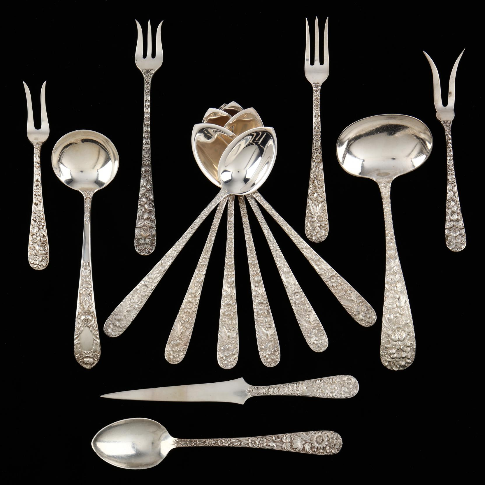 a-group-of-repousse-sterling-silver-flatware