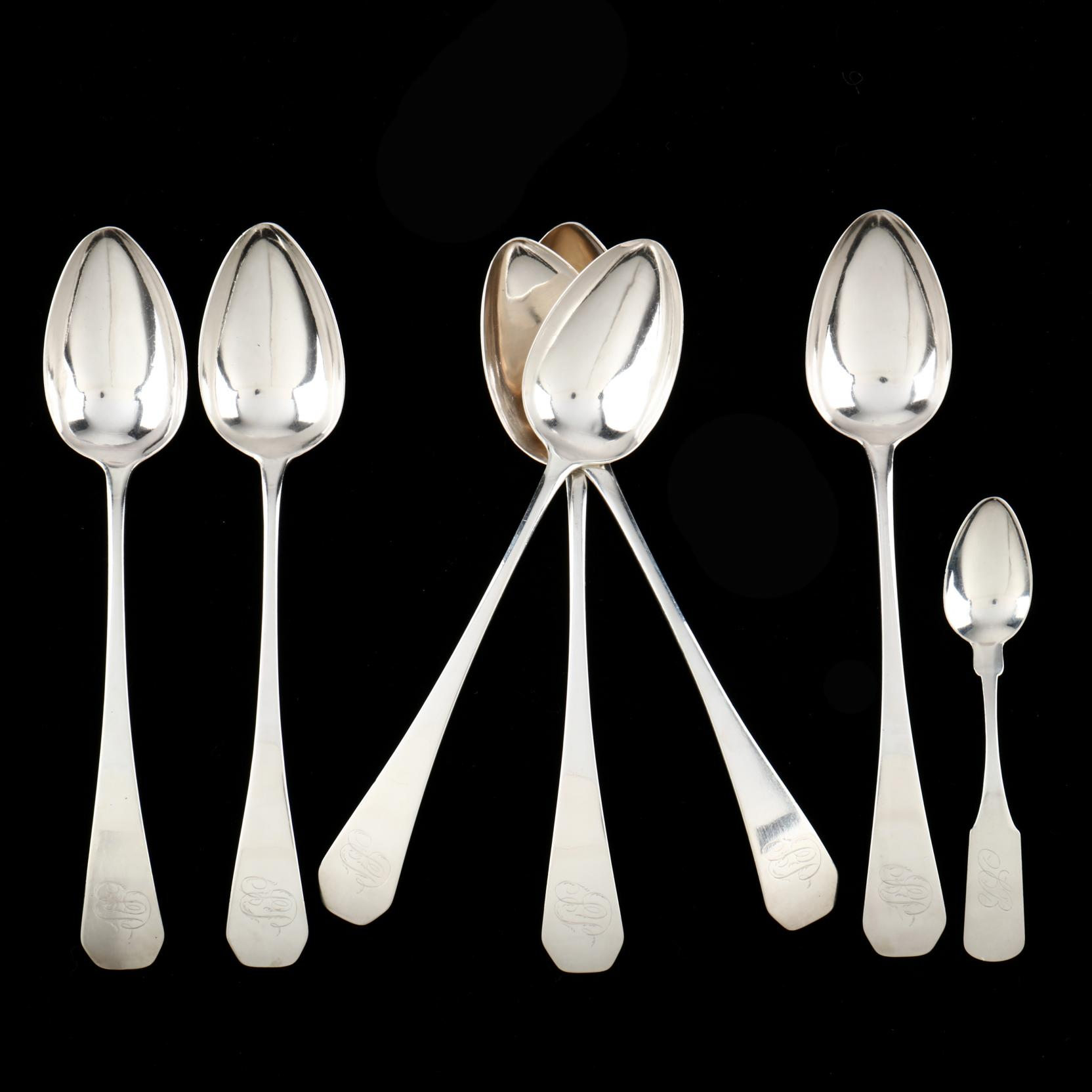 a-group-of-ct-coin-silver-flatware