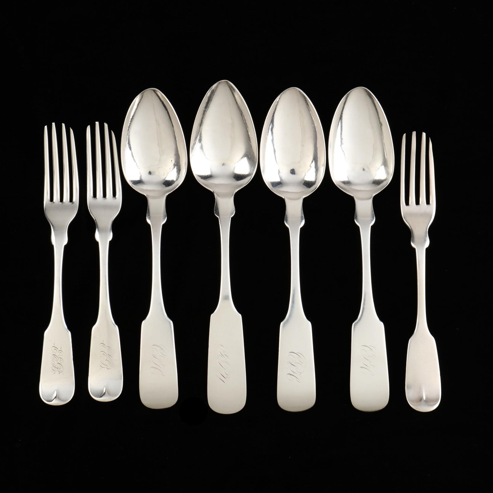 a-group-of-sc-coin-silver-flatware