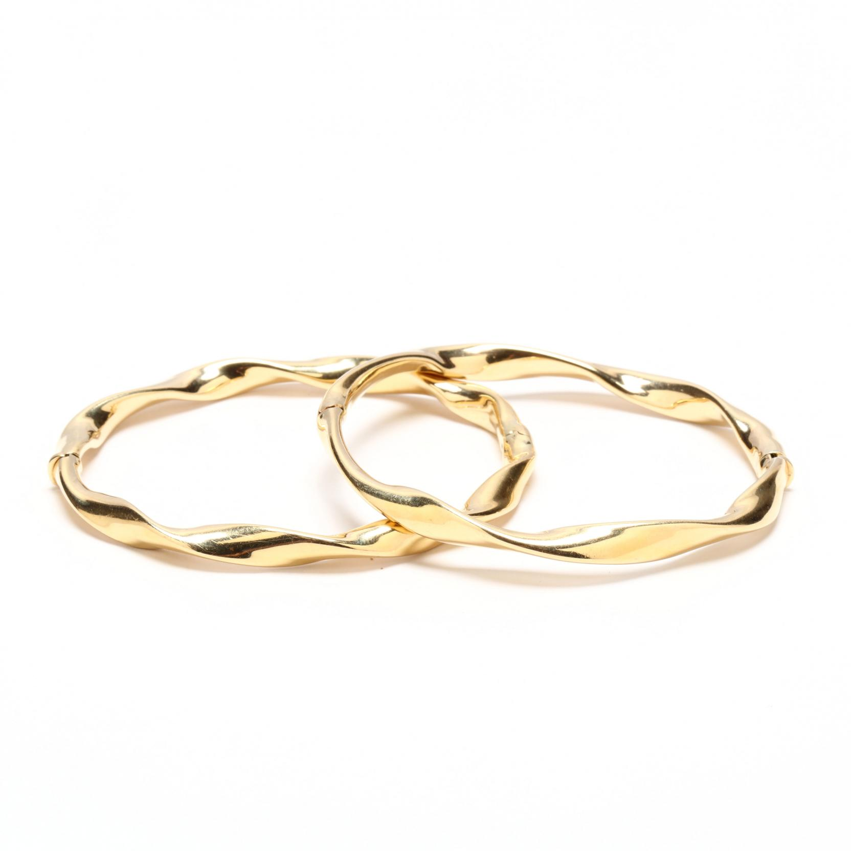 pair-of-14kt-gold-bangle-bracelets-italy