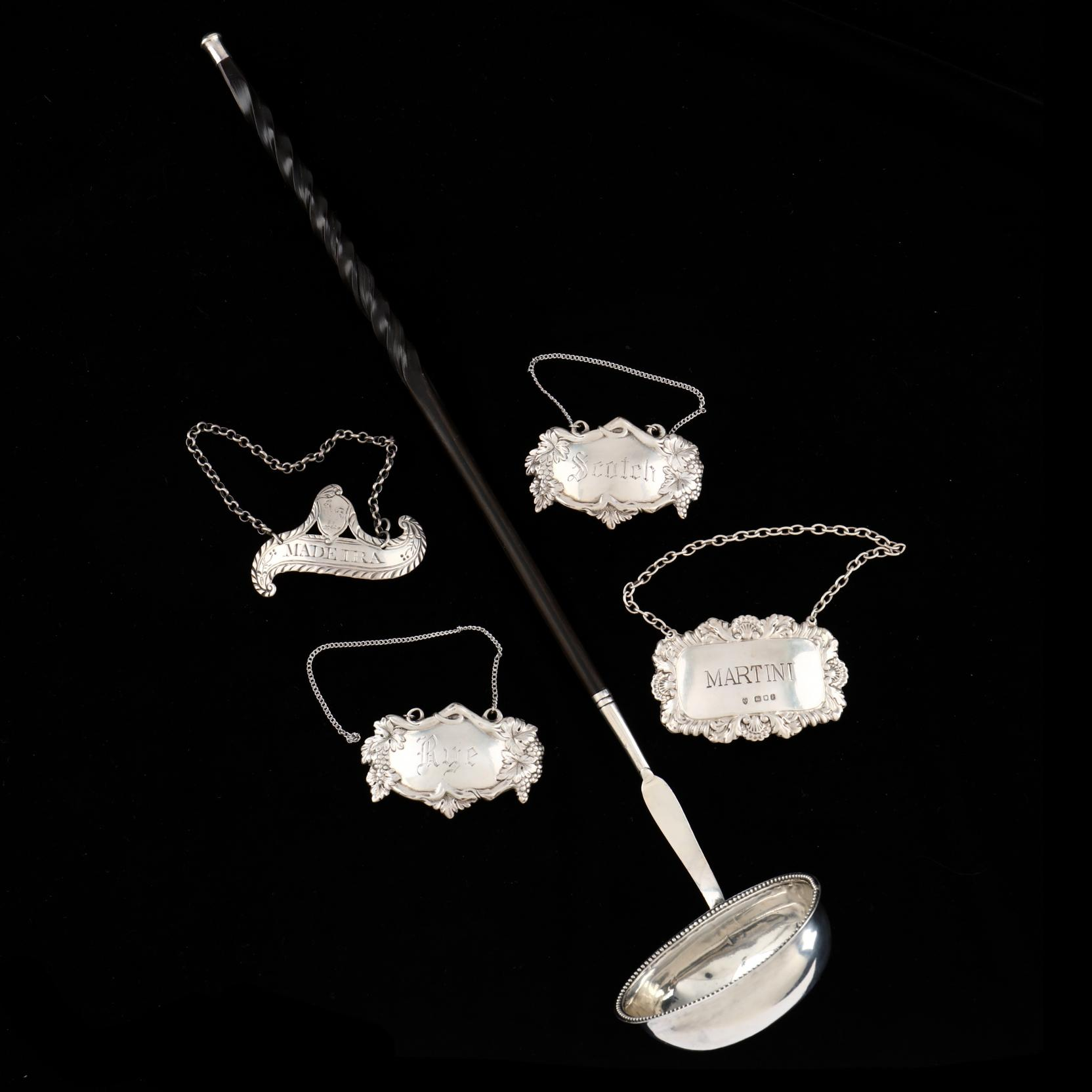 a-georgian-silver-toddy-ladle-and-four-silver-decanter-labels