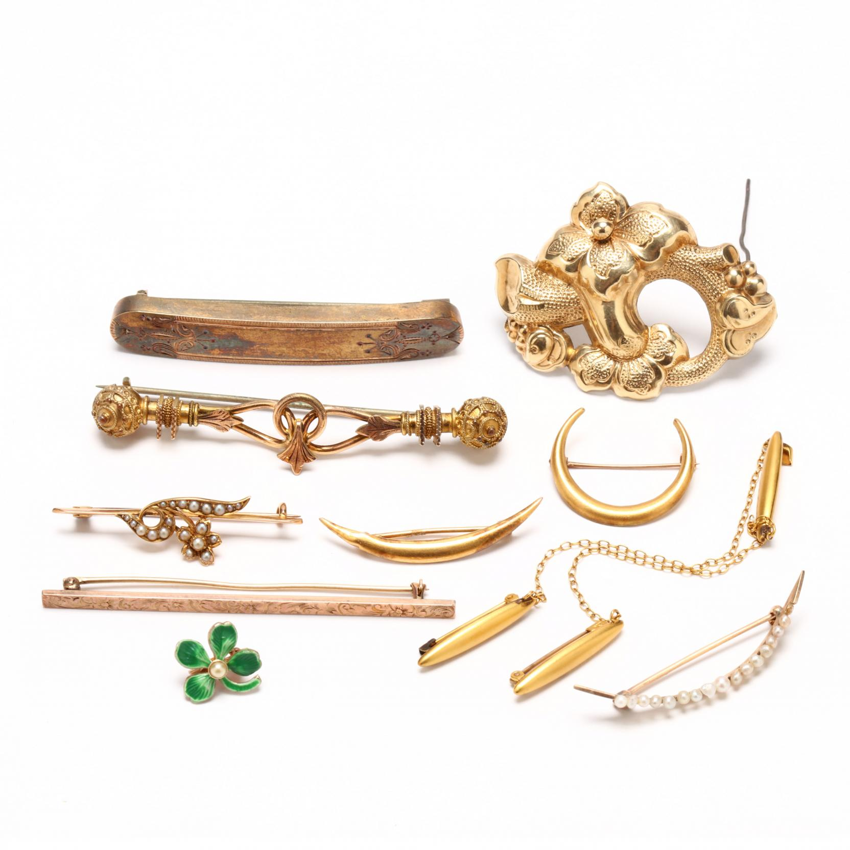 group-of-vintage-and-antique-pins-and-brooches