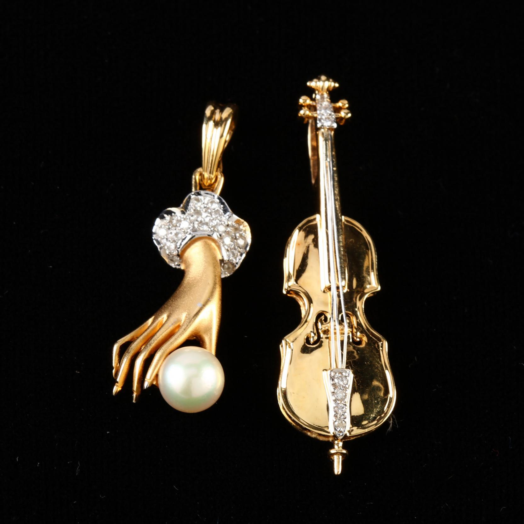 two-18kt-gold-and-gem-set-pendants
