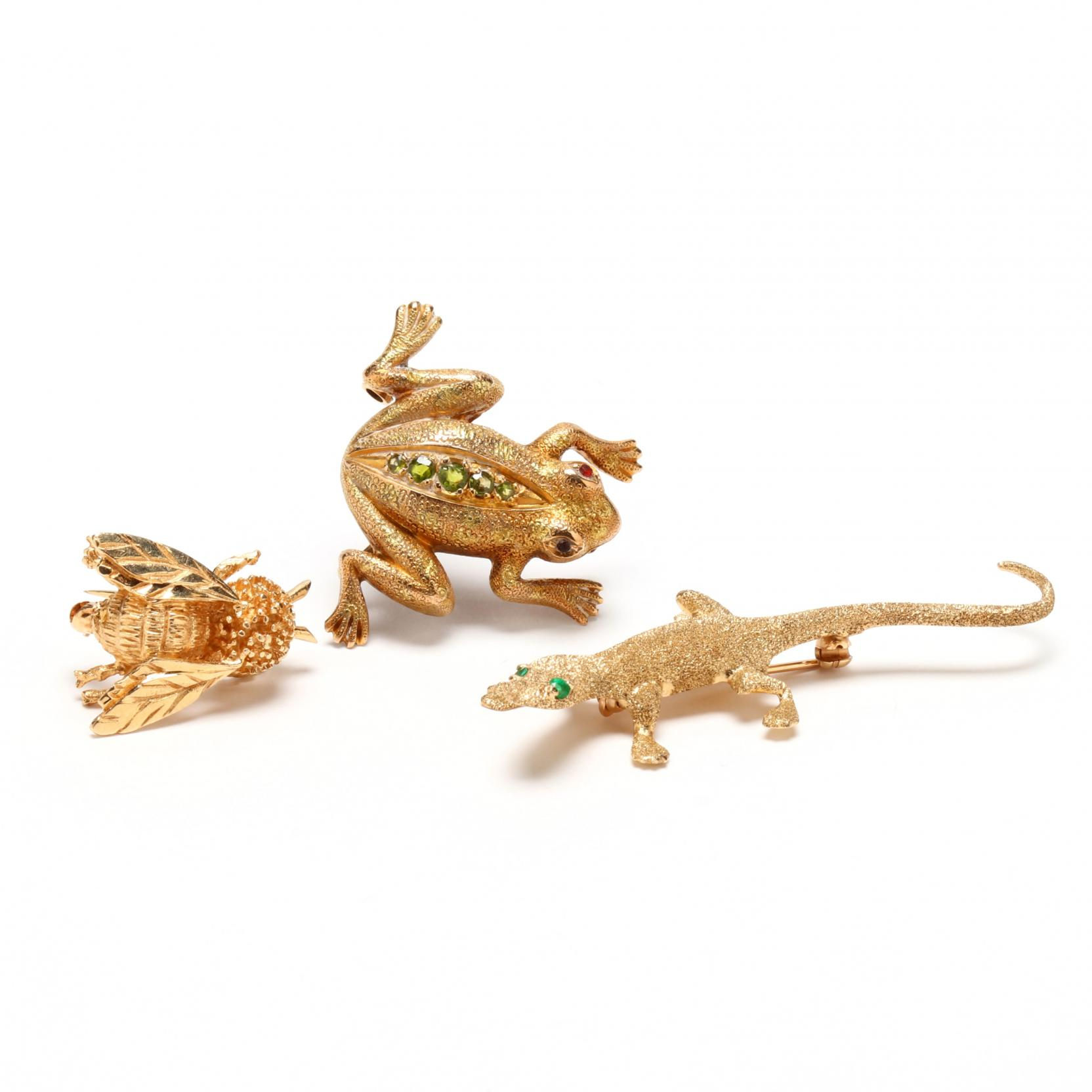 three-gold-figural-brooches