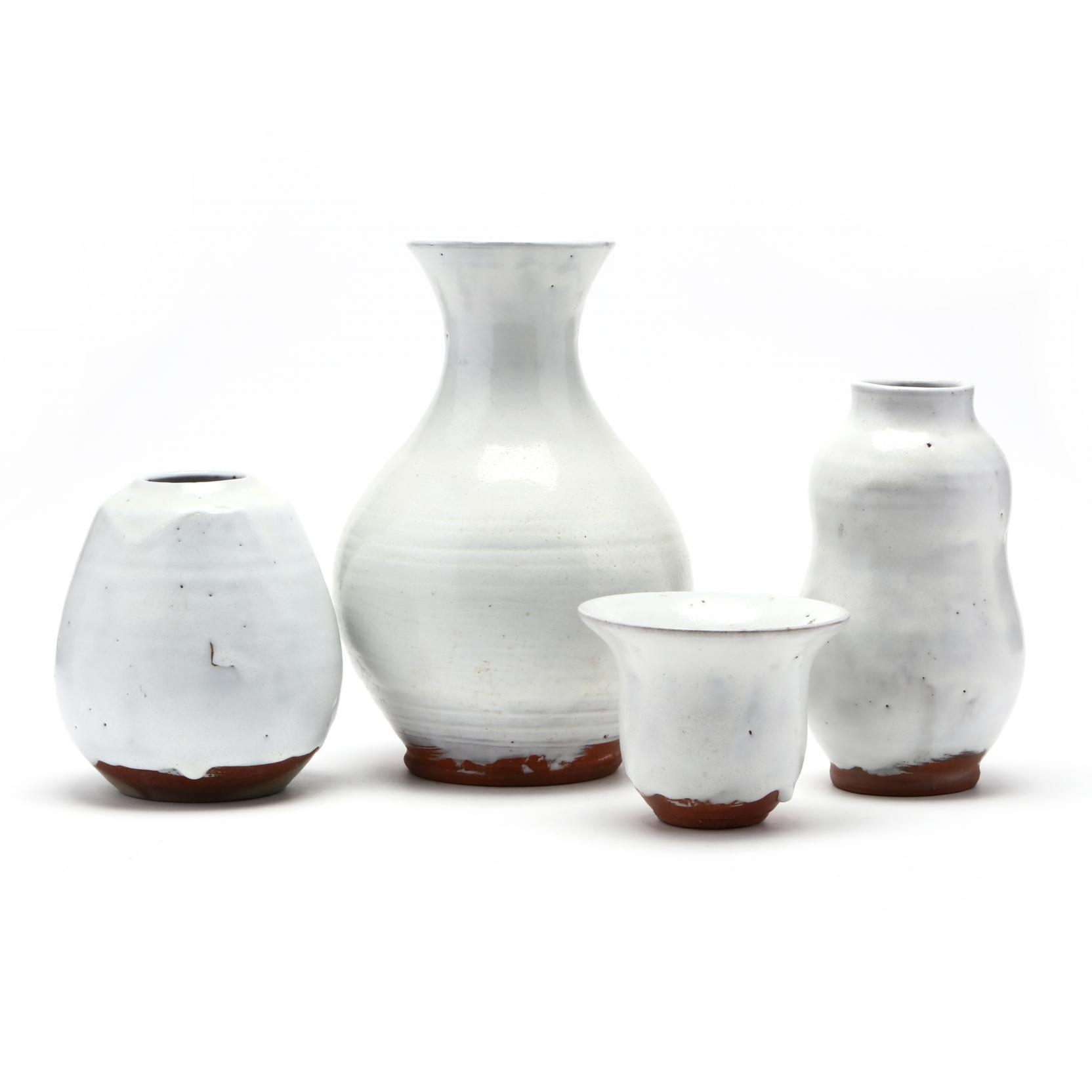 a-group-of-four-jugtown-chinese-white-vases