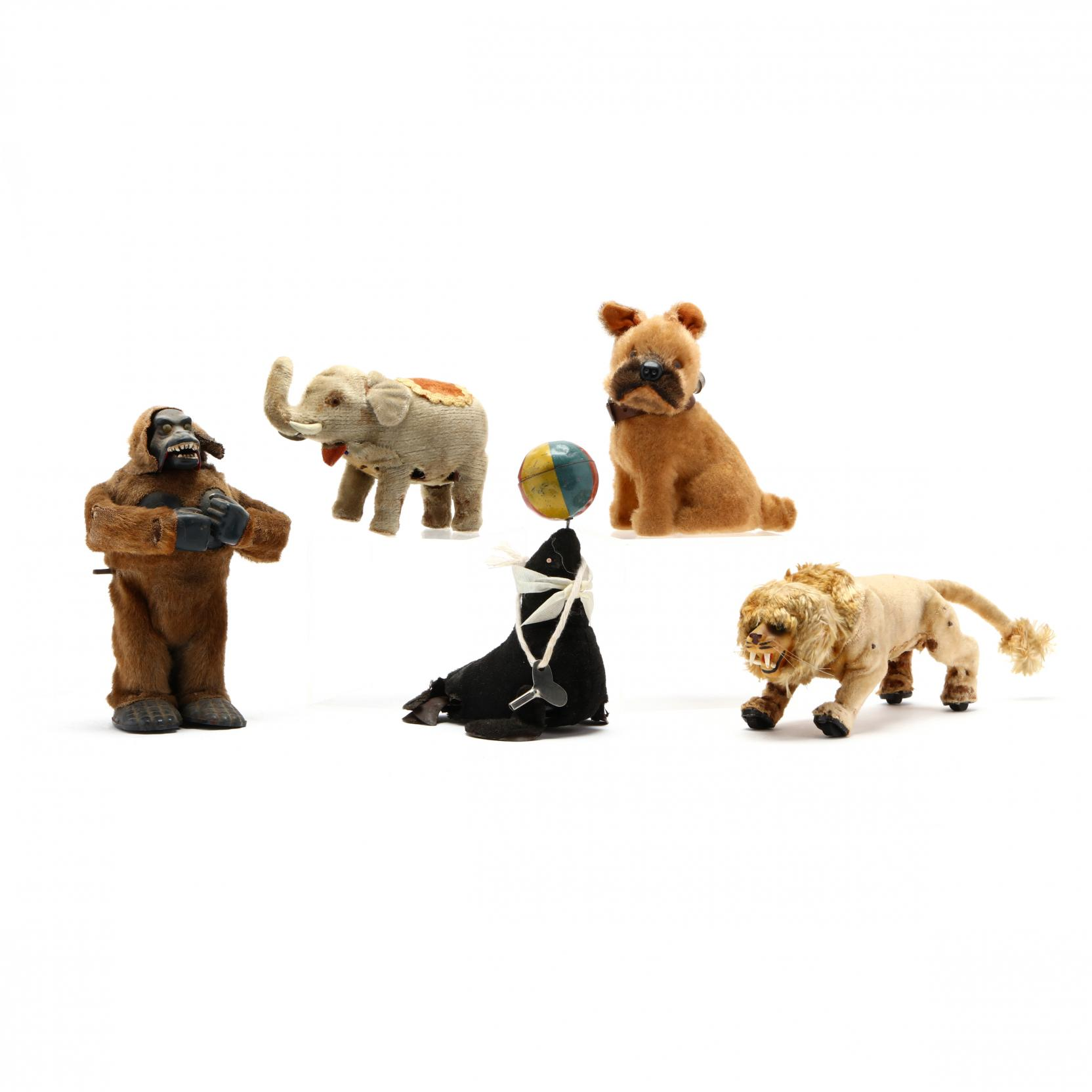 a-group-of-vintage-mohair-wind-up-animals
