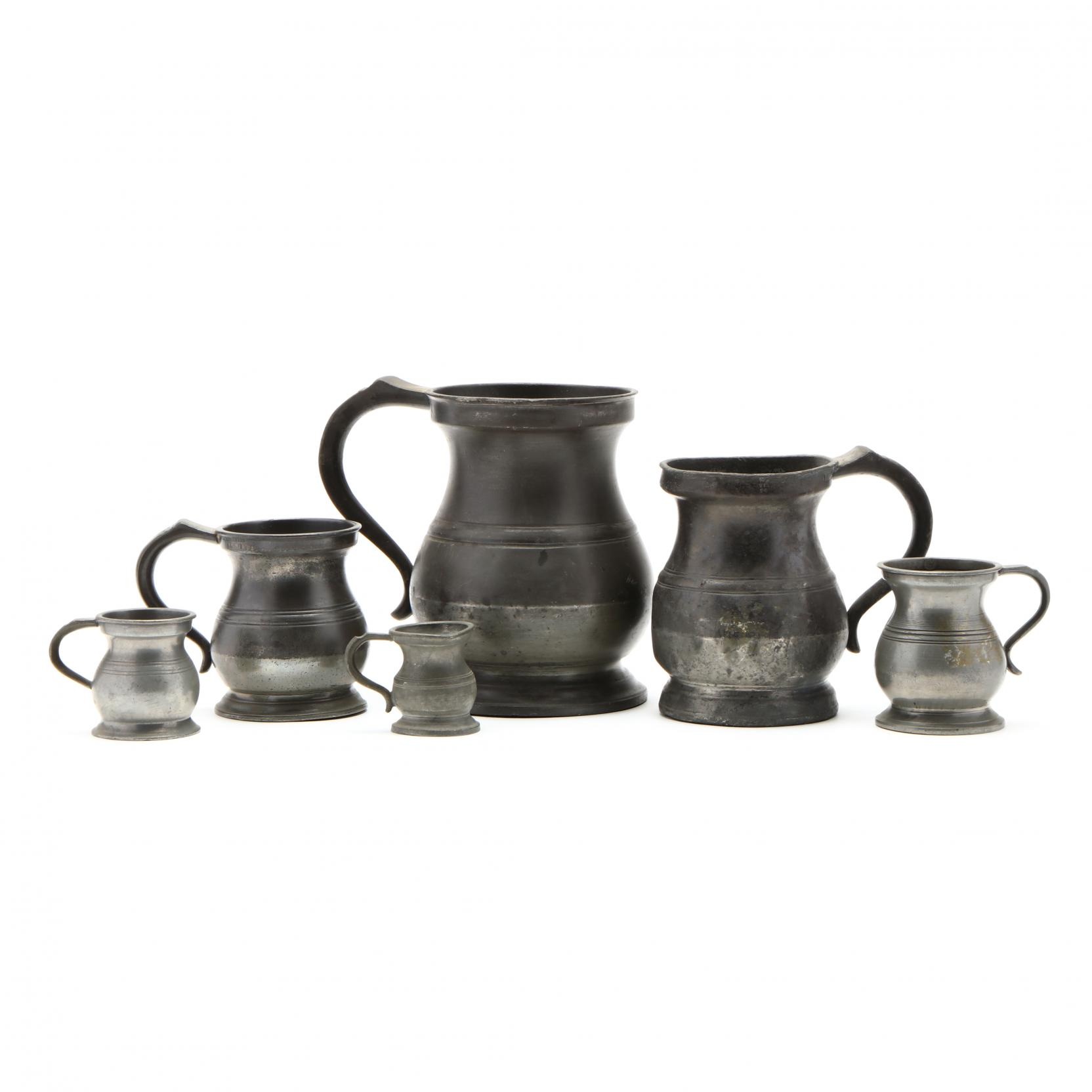 group-of-assembled-pewter-graduated-measuring-cups