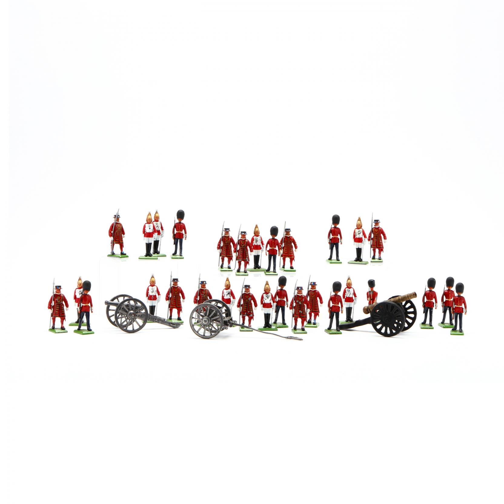 group-of-toys-soldiers-and-cannons
