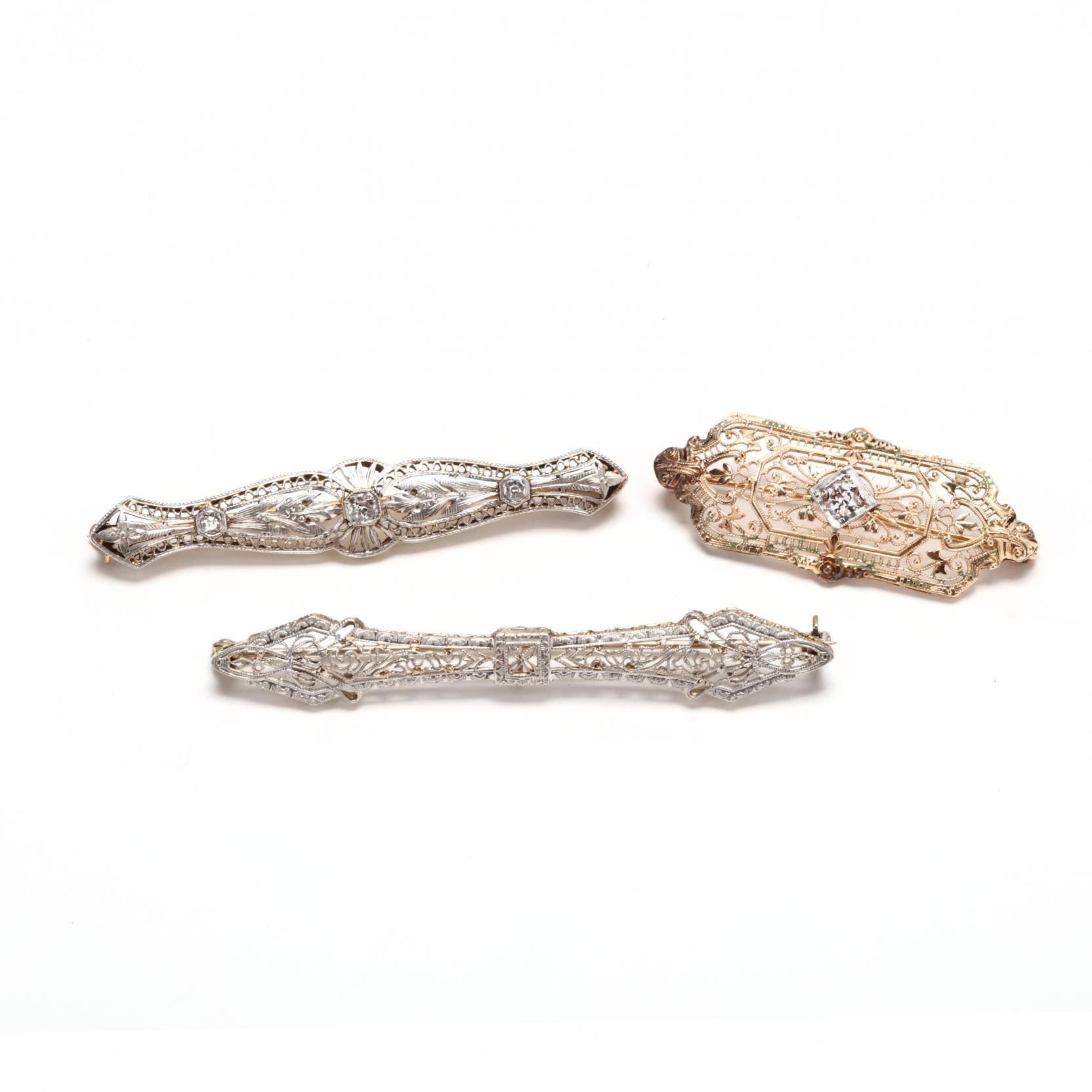 three-antique-brooches