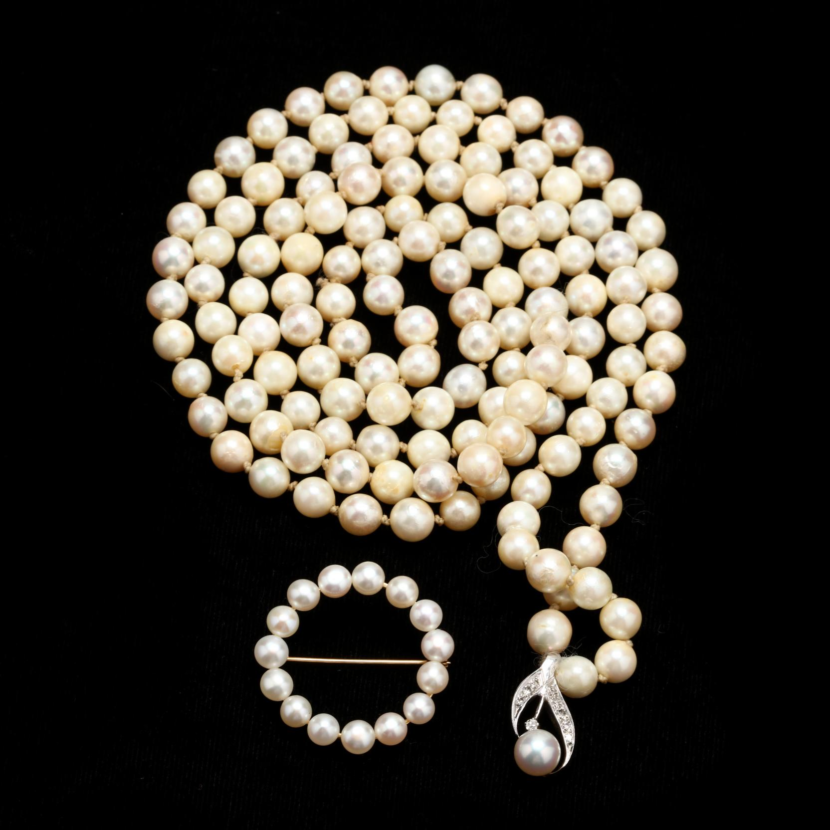 pearl-and-diamond-necklace-and-a-pearl-circle-brooch