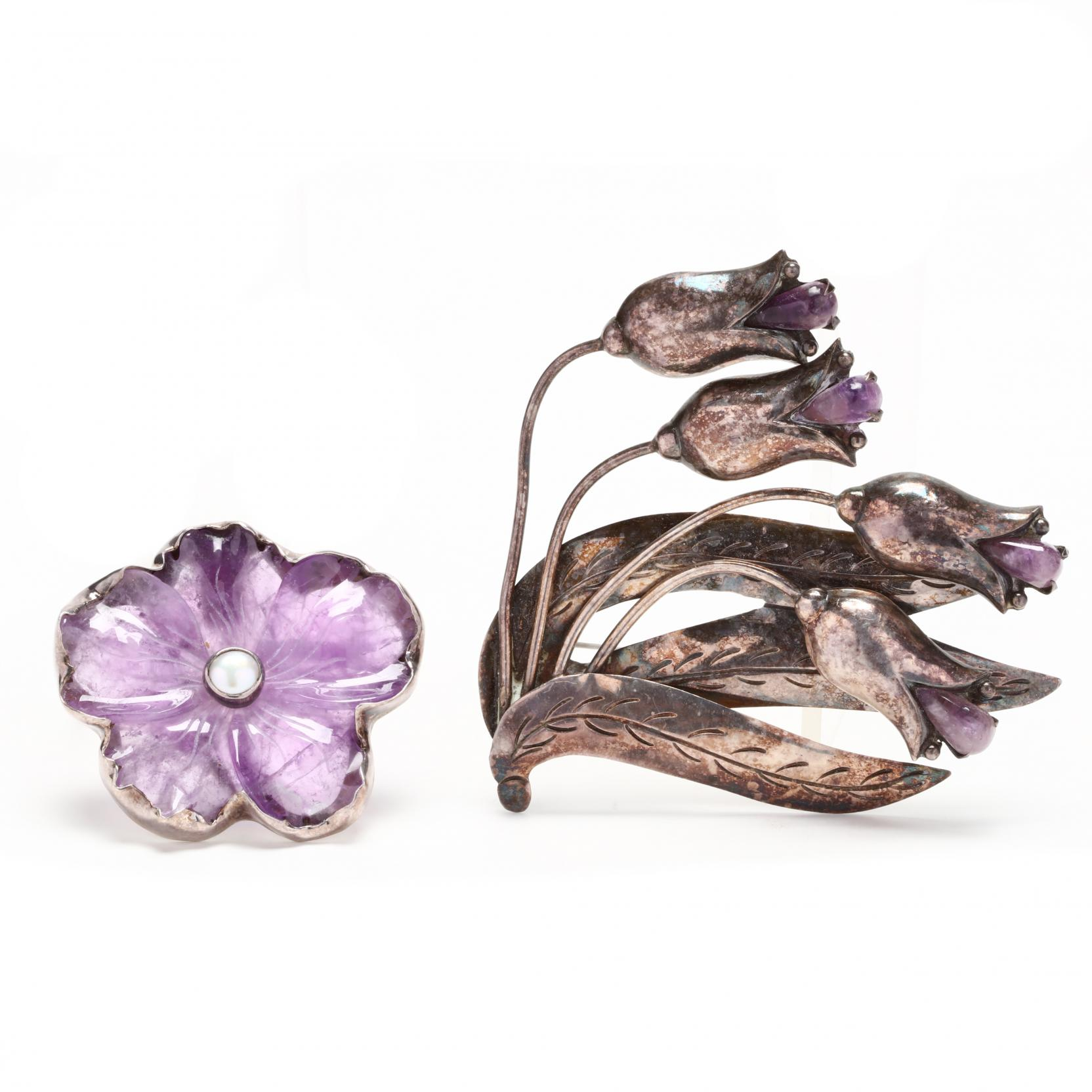 two-silver-and-amethyst-brooches