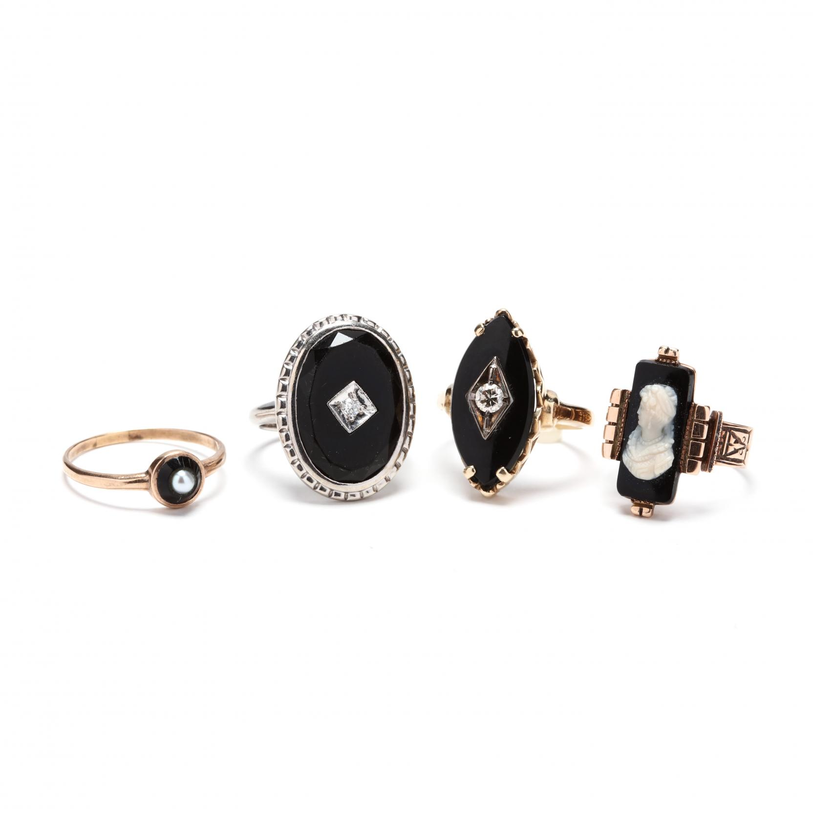 four-gold-and-gemstone-rings