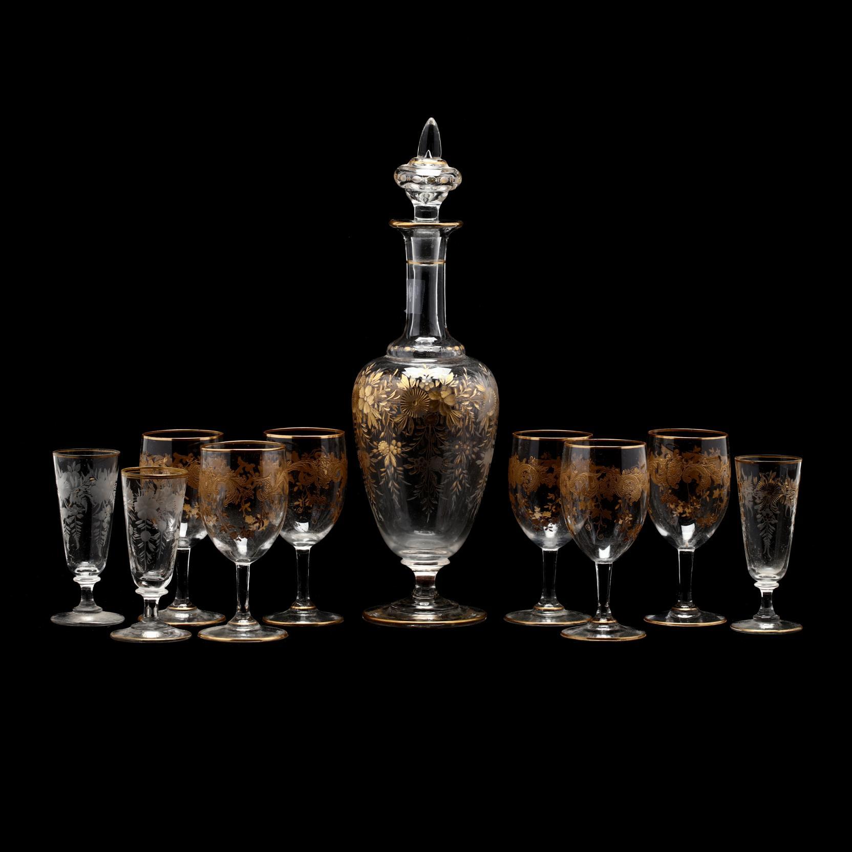 an-assembled-gilt-crystal-liqueur-set