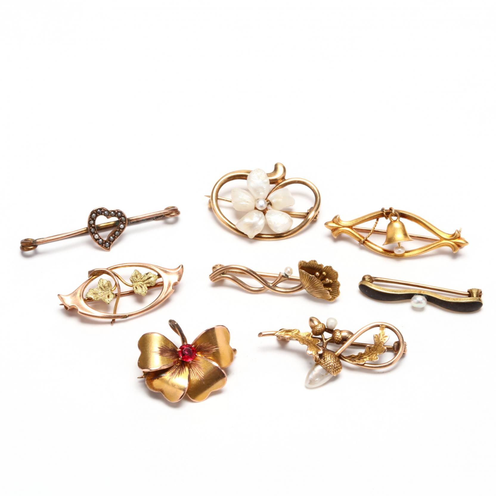 group-of-gold-brooches