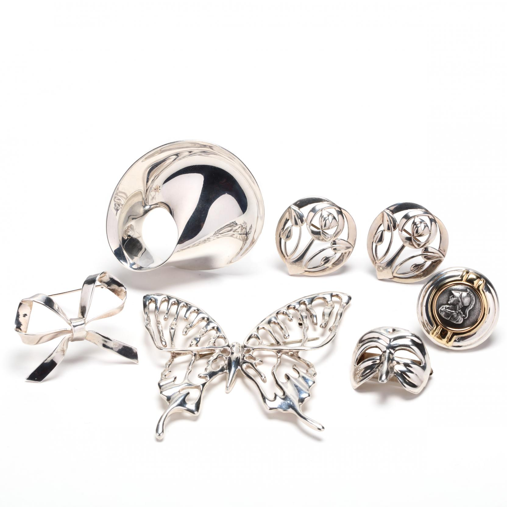 a-collection-of-fine-sterling-silver-brooches-signed