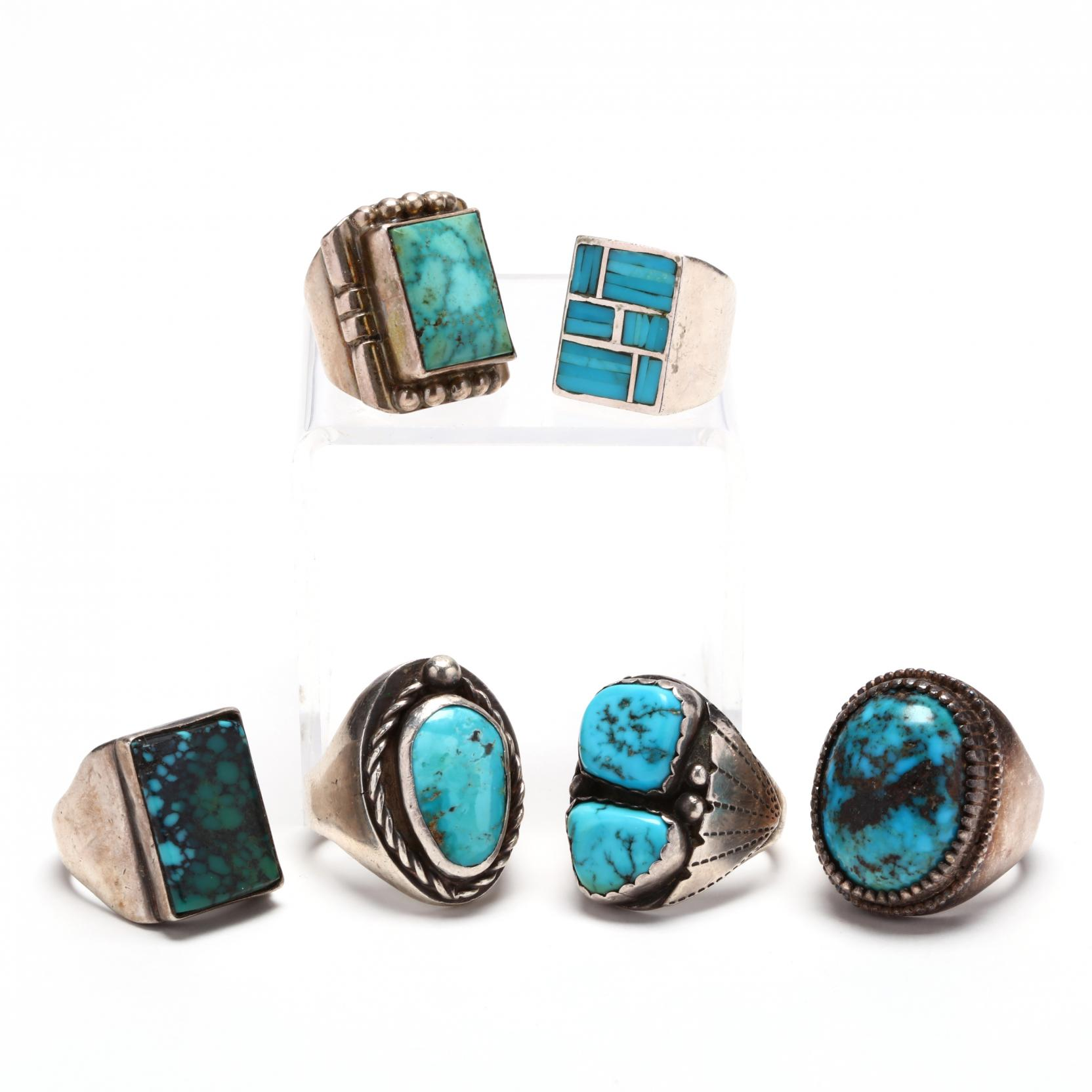 a-collection-of-six-turquoise-and-silver-rings