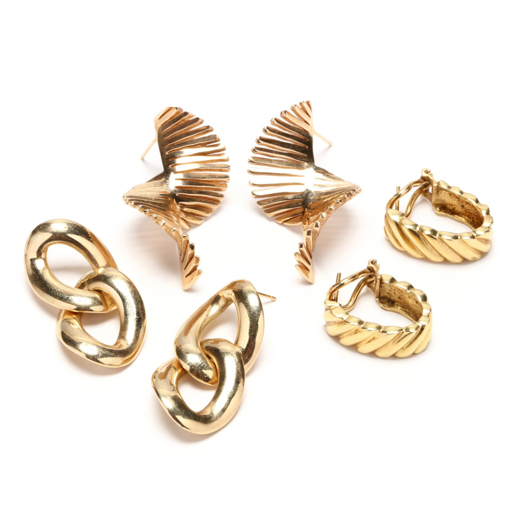 three-pairs-gold-earrings