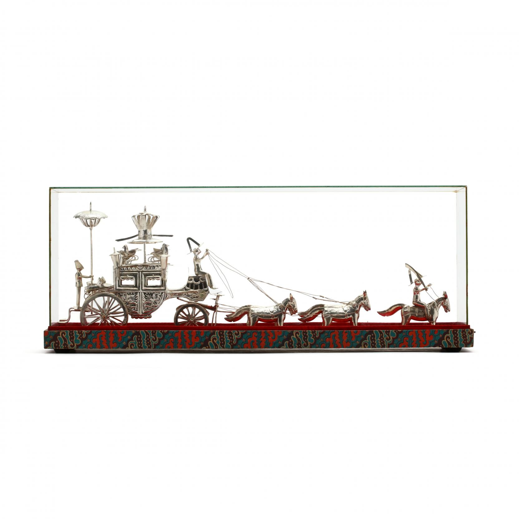 a-vintage-silver-carriage-in-a-glass-presentation-case