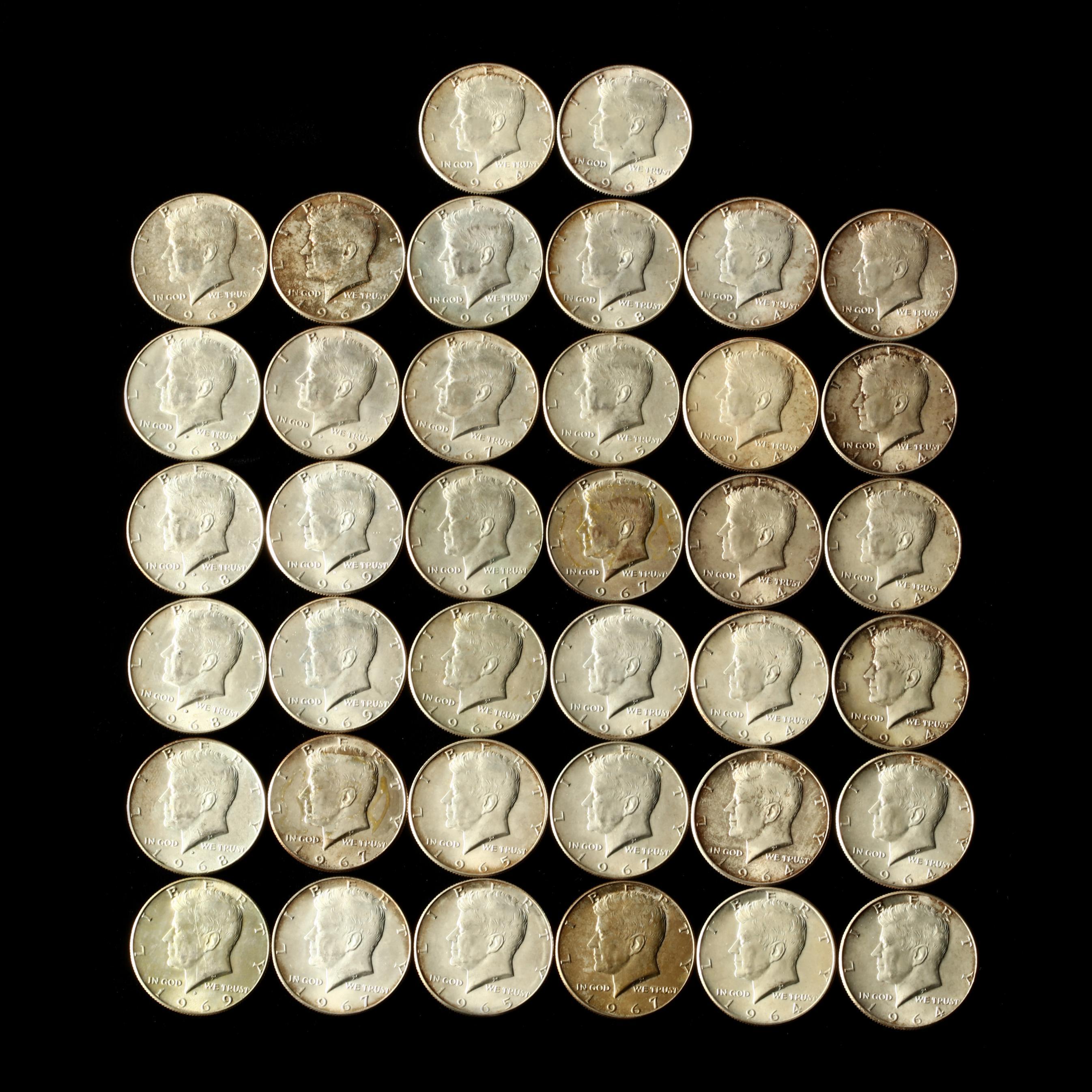 fourteen-1964-kennedy-halves-and-24-40-silver-kennedy-halves