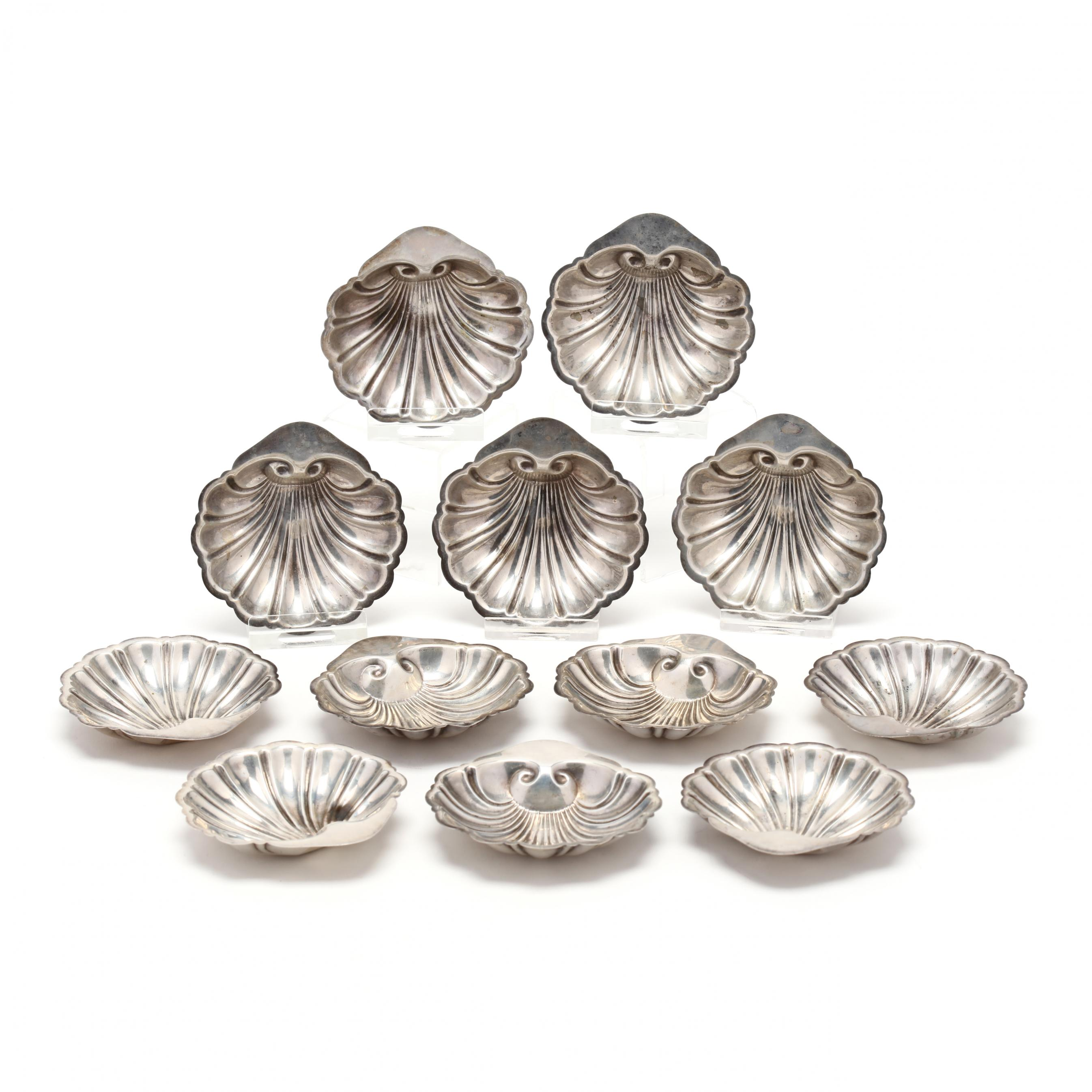 a-set-of-twelve-sterling-silver-shell-form-butter-pats