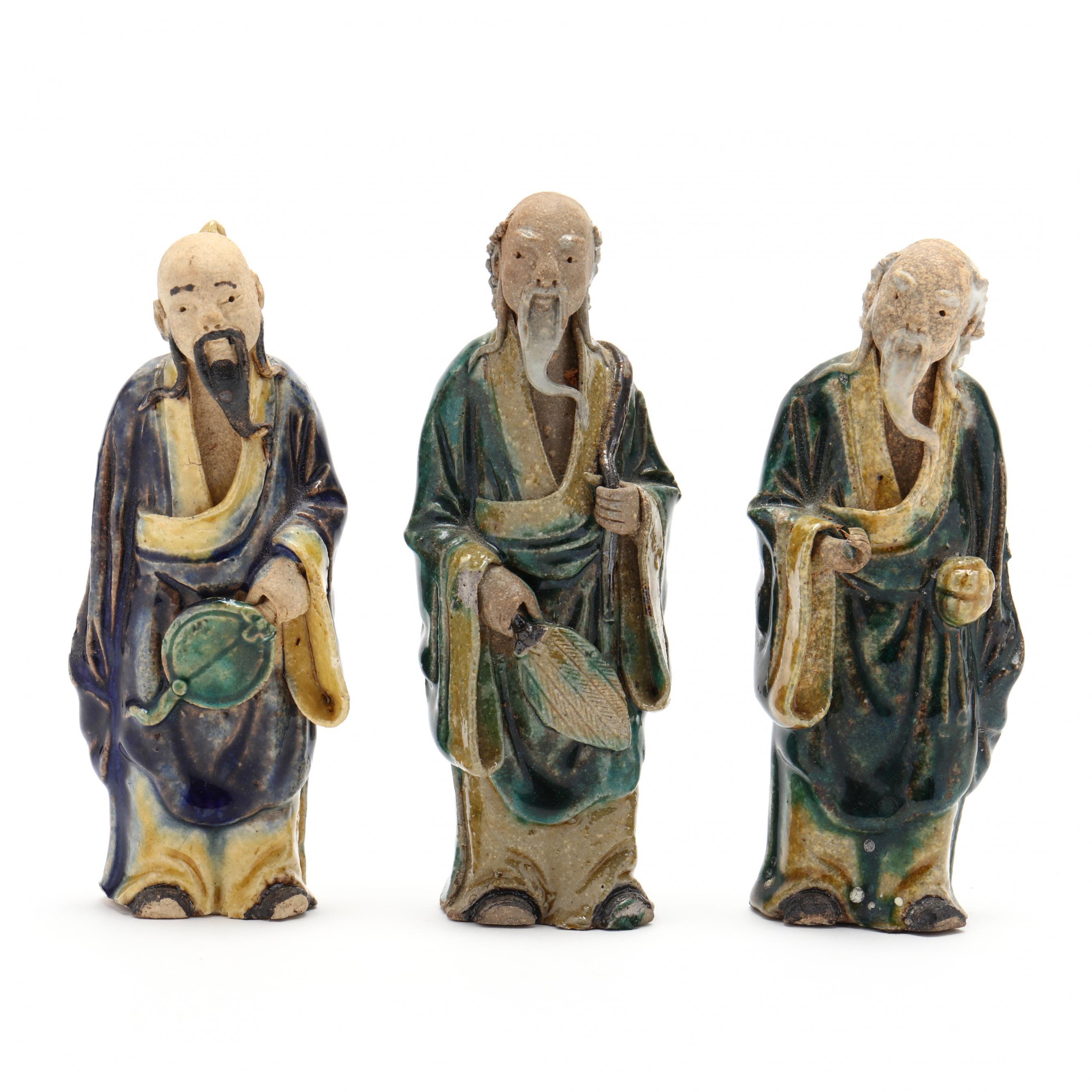 three-chinese-pottery-mud-men