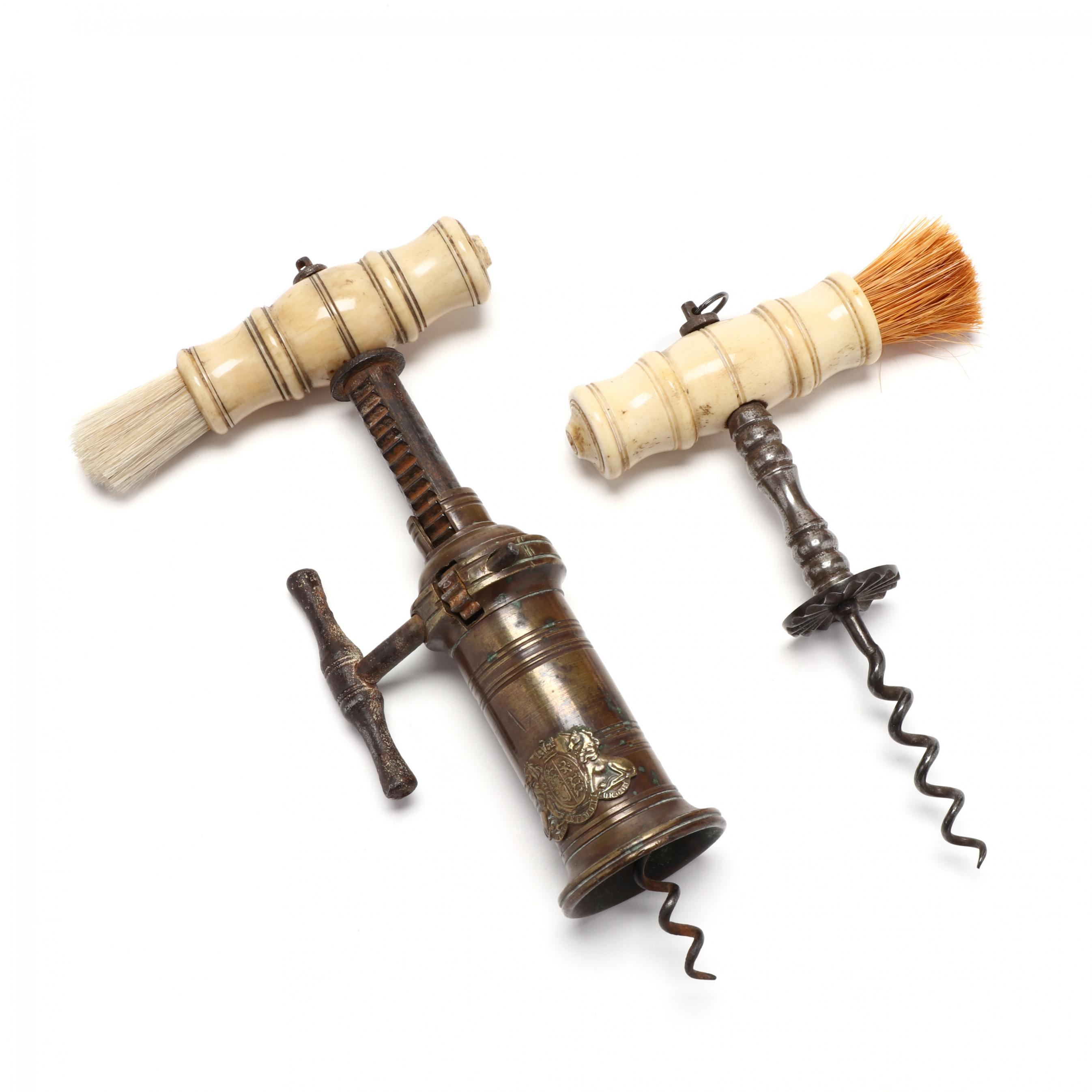 two-antique-carved-bone-bottle-openers