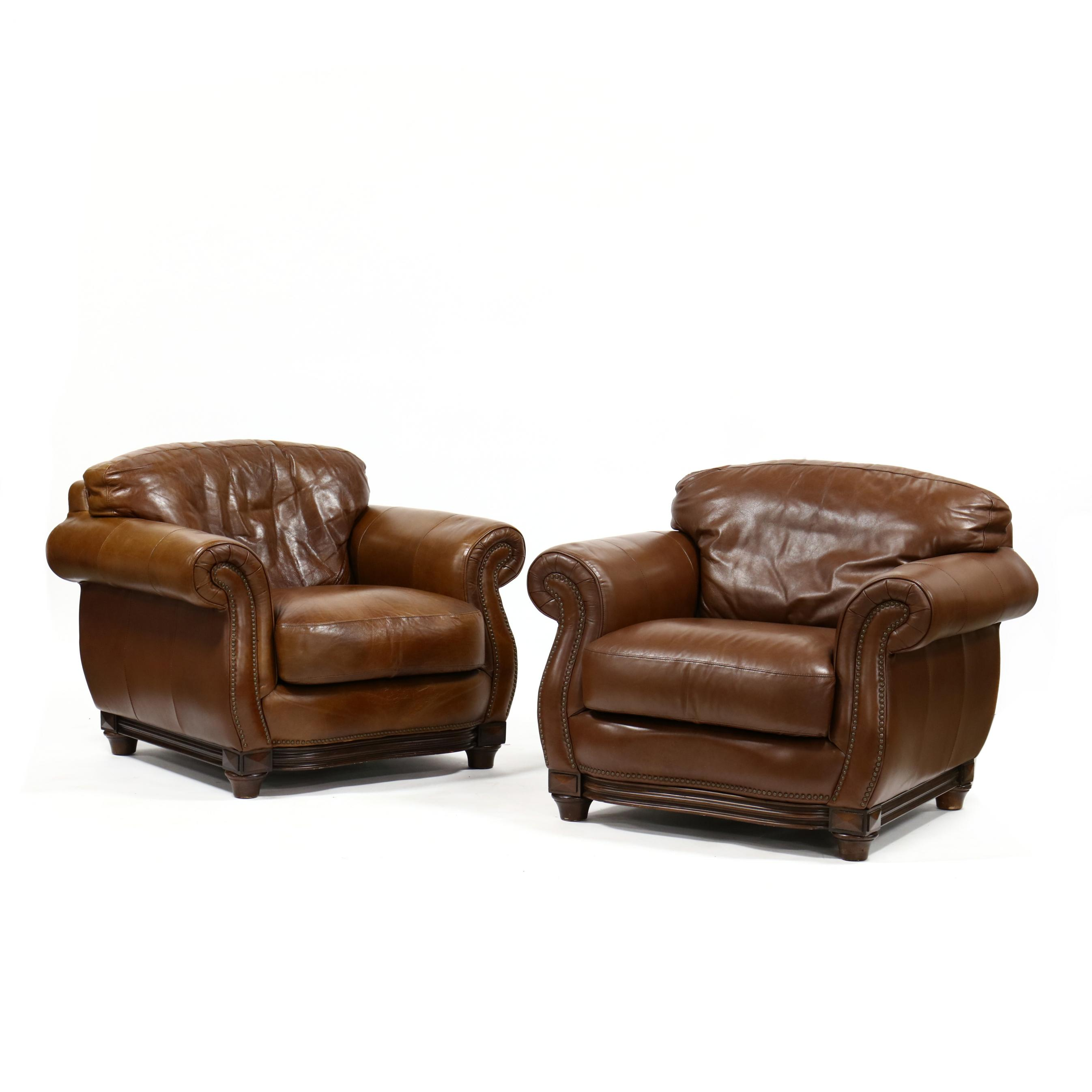 robinson-and-robinson-inc-pair-of-leather-upholstered-club-chairs