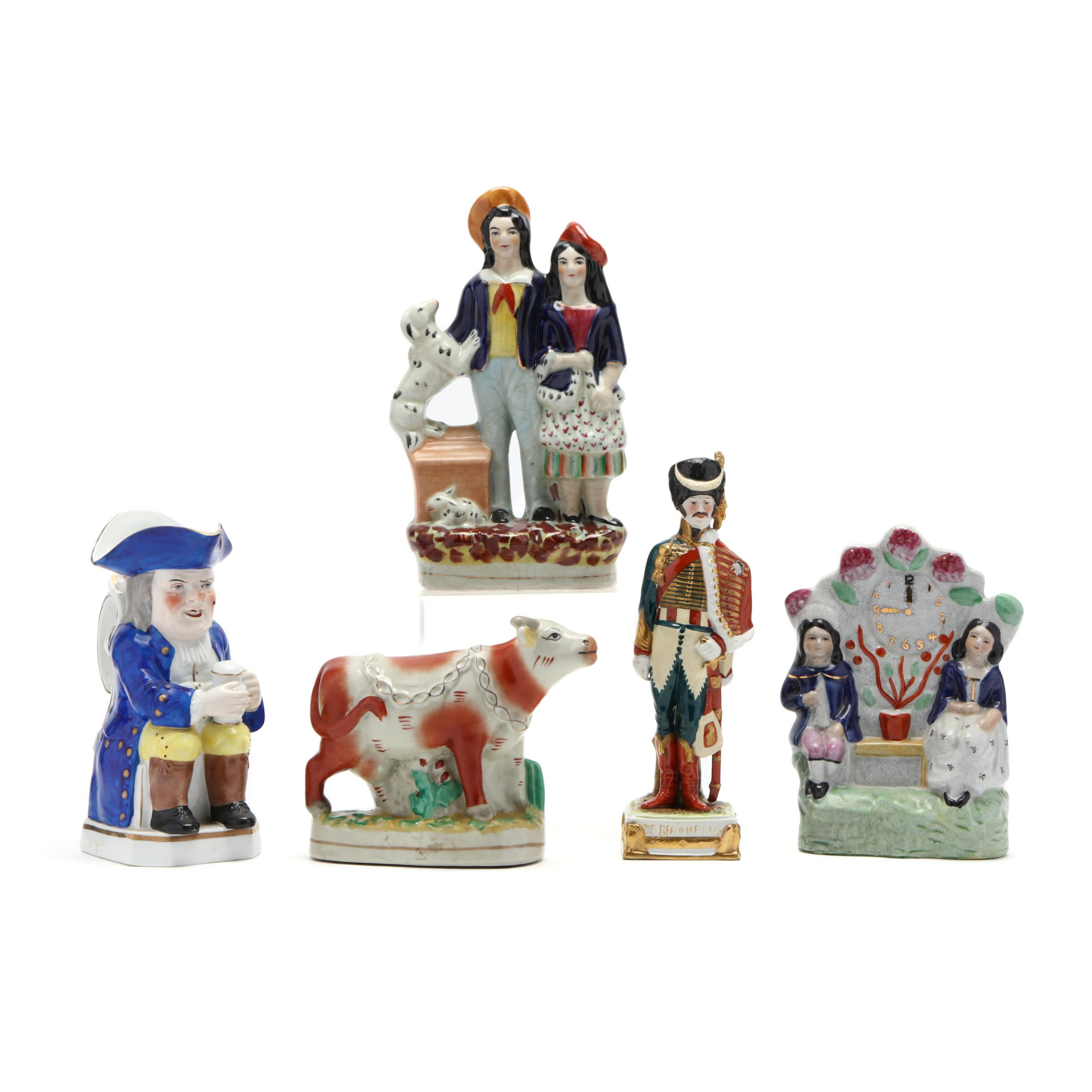 a-group-of-antique-figurines