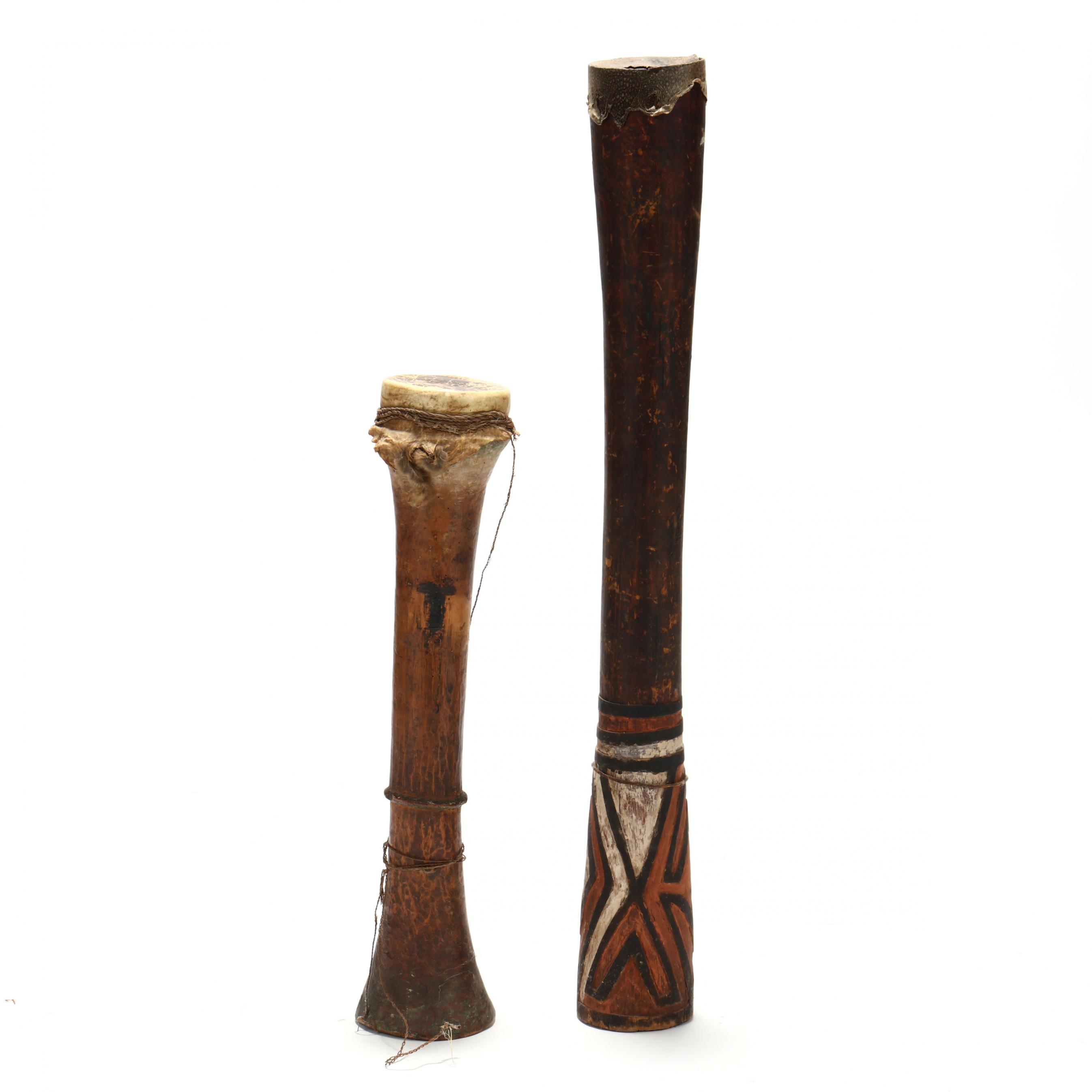 papua-new-guinea-two-elongated-wooden-tribal-drums