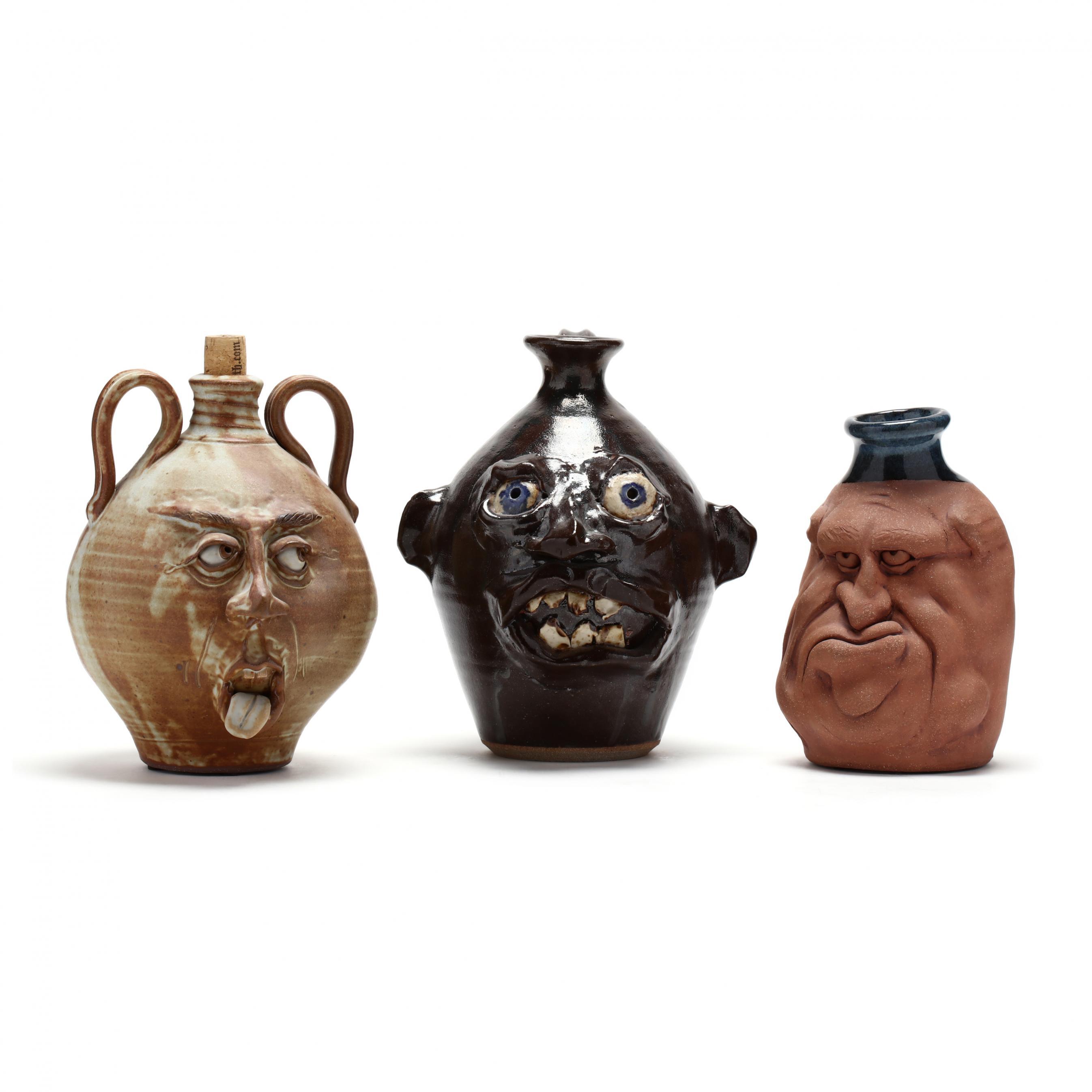 three-nc-pottery-face-jugs