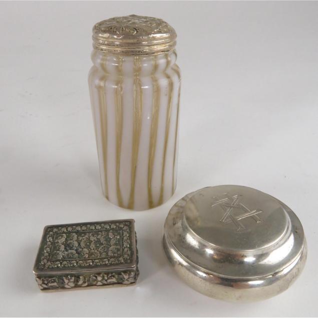 three-silver-vanity-items