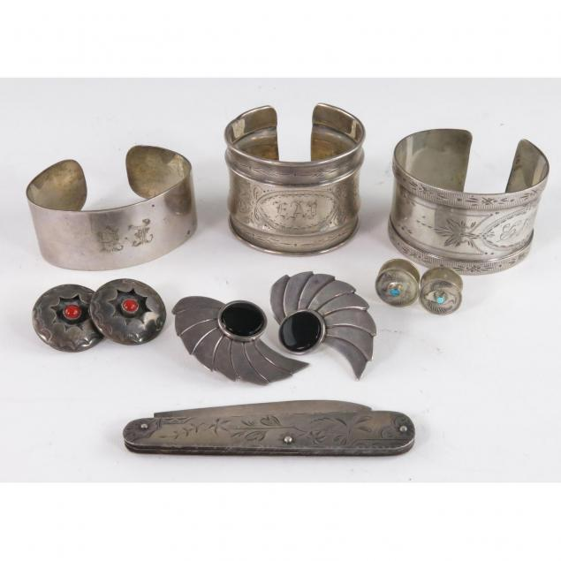 group-of-silver-jewelry-and-accessories