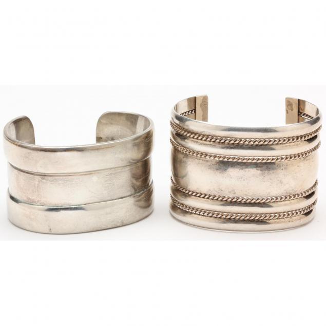 two-wide-silver-cuff-bracelets