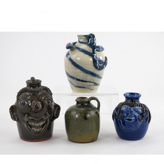 four-pottery-jugs
