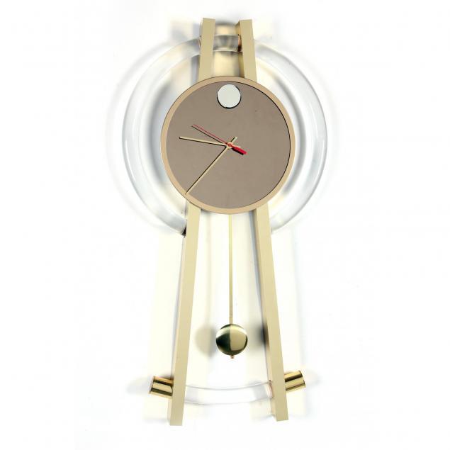 modernist-lucite-and-brass-compass-form-wall-clock