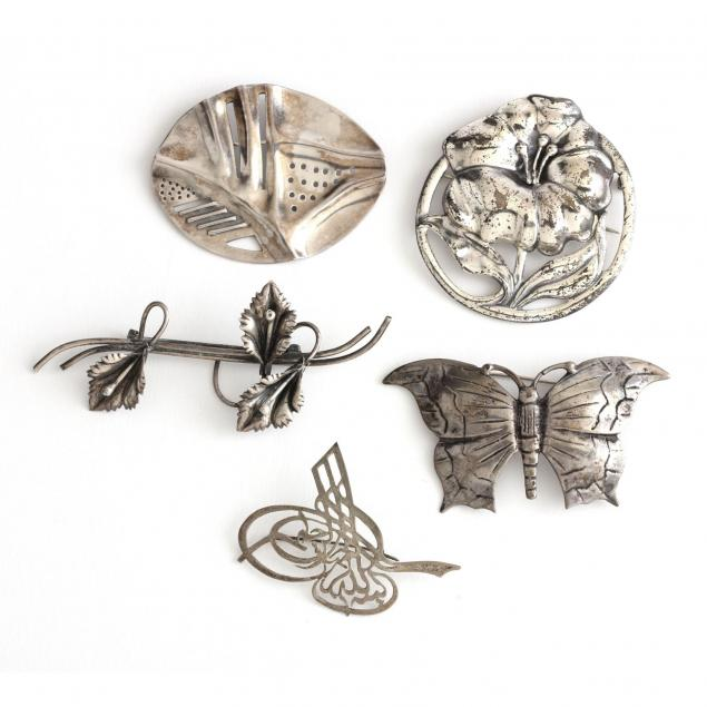 five-silver-brooches