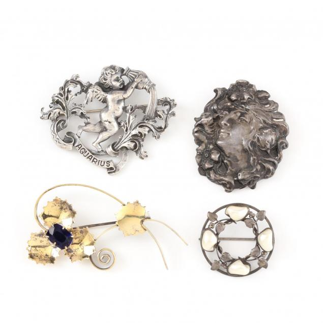 four-vintage-silver-brooches