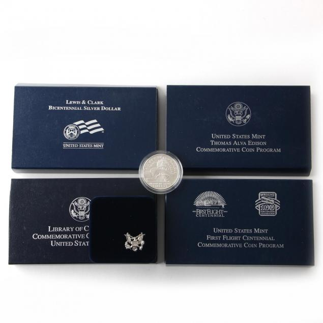 four-different-proof-commemorative-silver-dollars