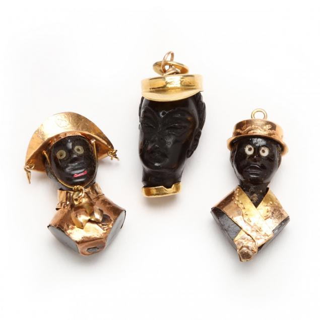 three-gold-and-ebony-blackamoor-charms-one-signed-corletto