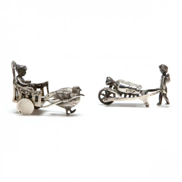 two-silver-miniatures