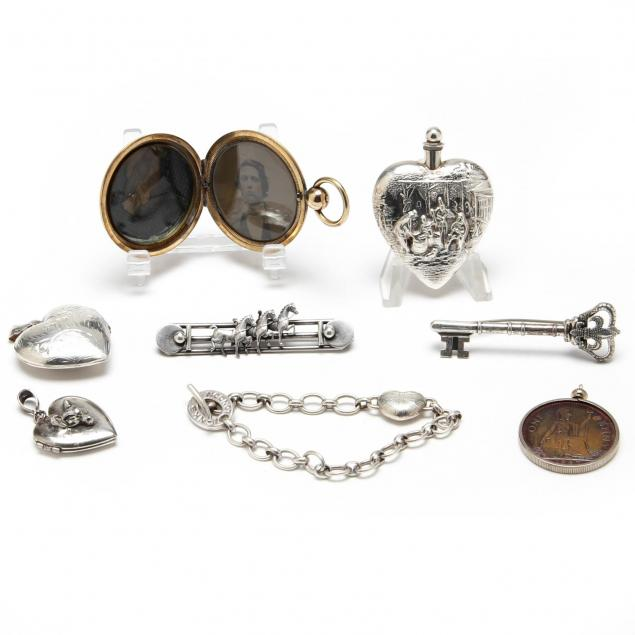 a-collection-of-eight-silver-lady-s-accessories